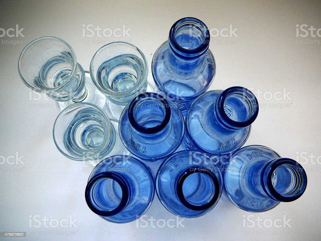Aquavit glasses and Blue Bottles stock photo