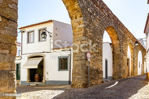 istock Aqueduct in the middle of the city of Evora 1154808845