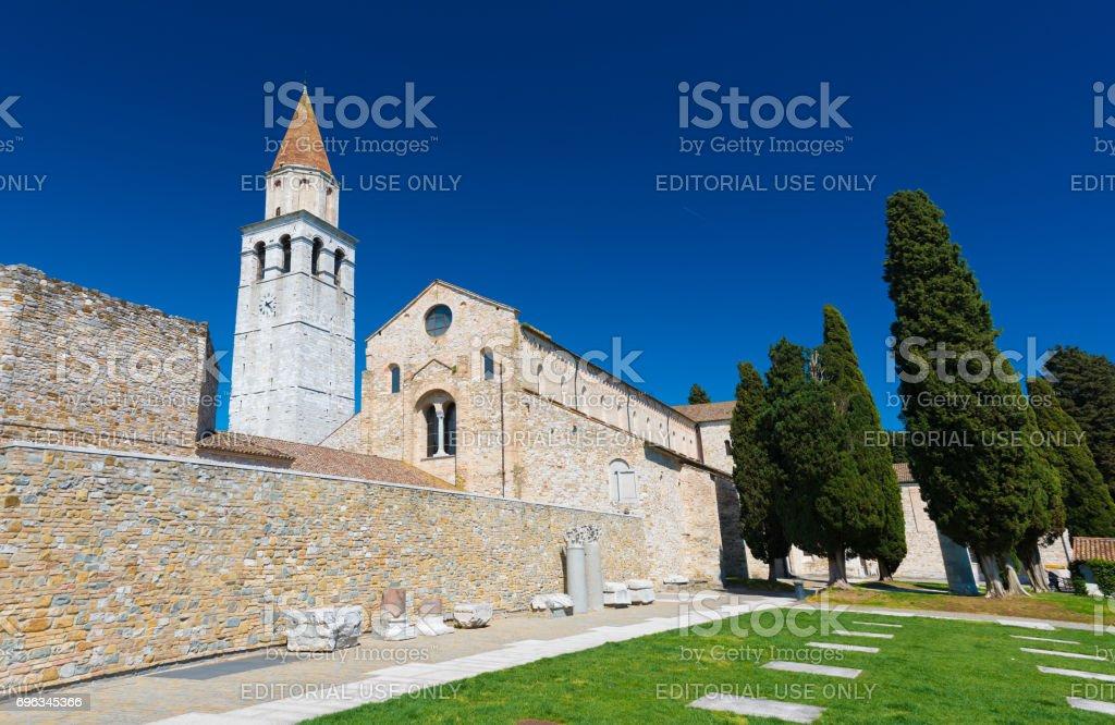 Aquileia, Italy: Basilica di Santa Maria Assunta and Ancient Ruins in Italian city of Aquileia, also known as Ancient Rome Port stock photo