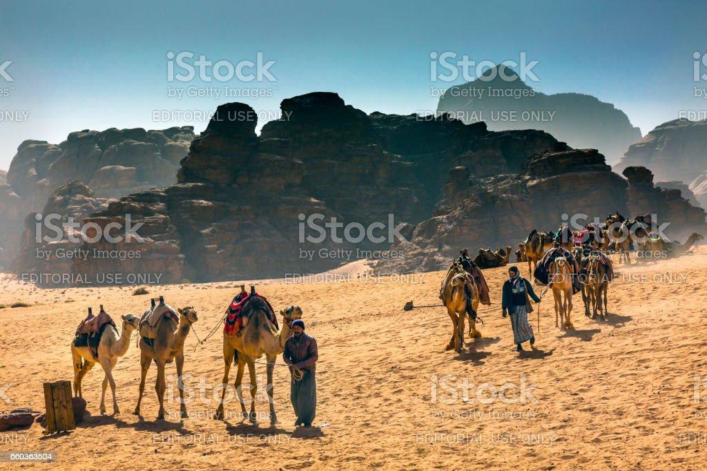 Arab Bedouin Guides Camels Valley of Moon Wadi Rum Jordan stock photo