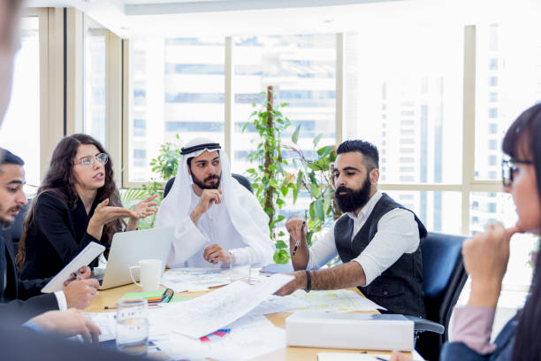 Arab business executive chairing an important business meeting stock photo