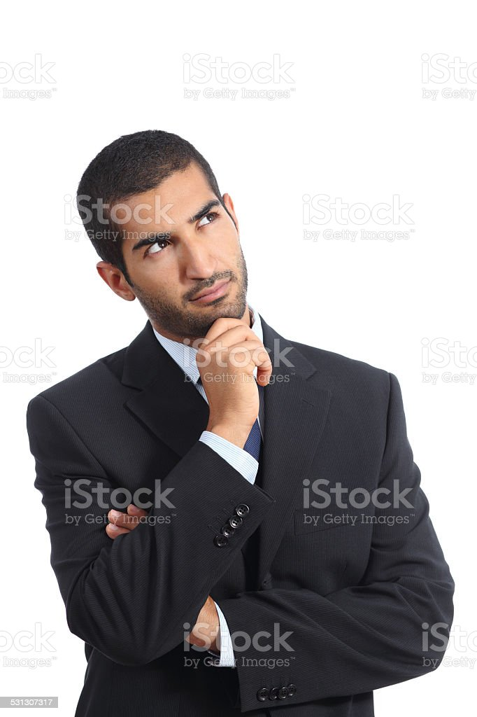 Arab business man thinking serious looking sideways stock photo