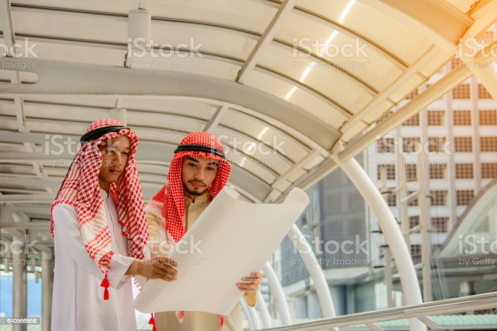 Arab Business people having consultanting with city background. stock photo
