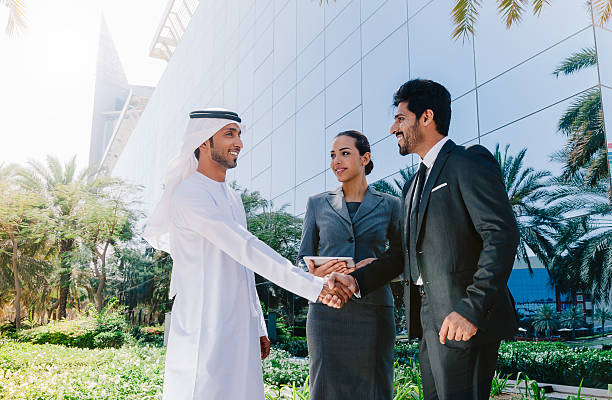 Arab business people shaking hands stock photo