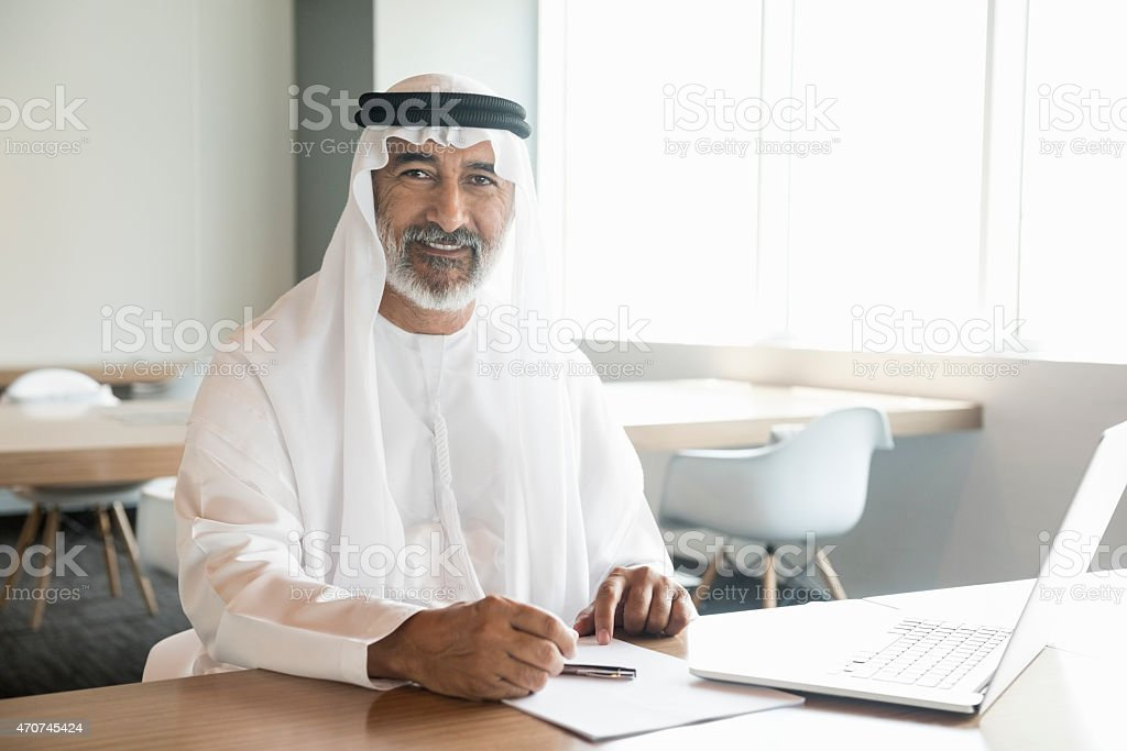 Arab businessman confident and smiling in office stock photo
