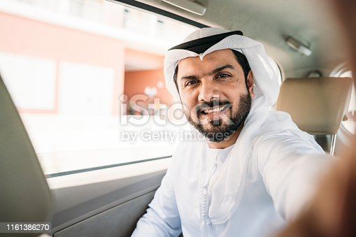 491496340 istock photo Arab businessman doing a selfie inside a taxi 1161386270