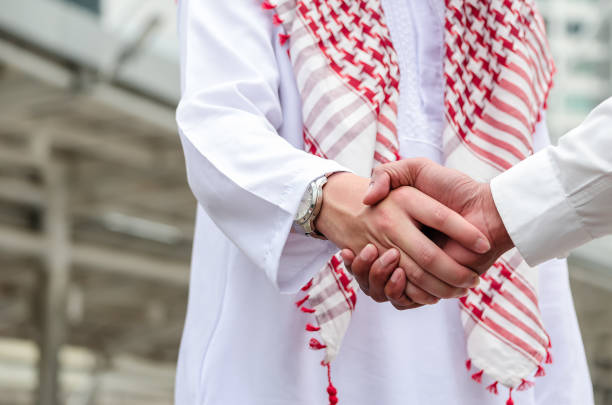 Arab businessman handshake with partner outdoor.  Greeting.  Business agreement. Arab businessman handshake with partner outdoor.  Greeting.  Business agreement. saudi arabia stock pictures, royalty-free photos & images