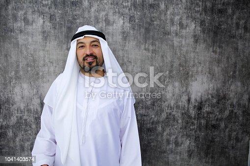 Arab businessman standing in office