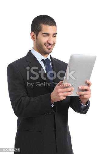 istock Arab businessman working reading a tablet ereader 500406745