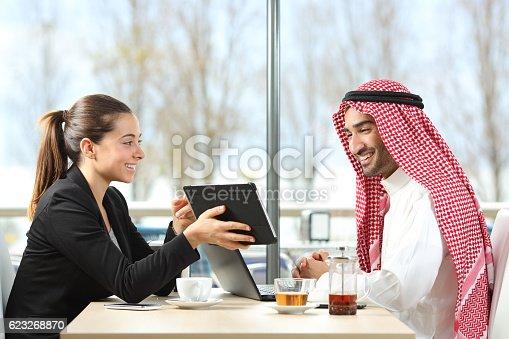 istock Arab businessman working with his coworker 623268870