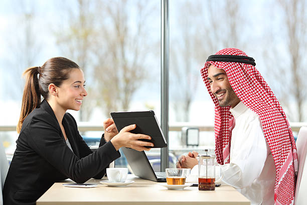 arab businessman working with his coworker - günstige hotels stock-fotos und bilder