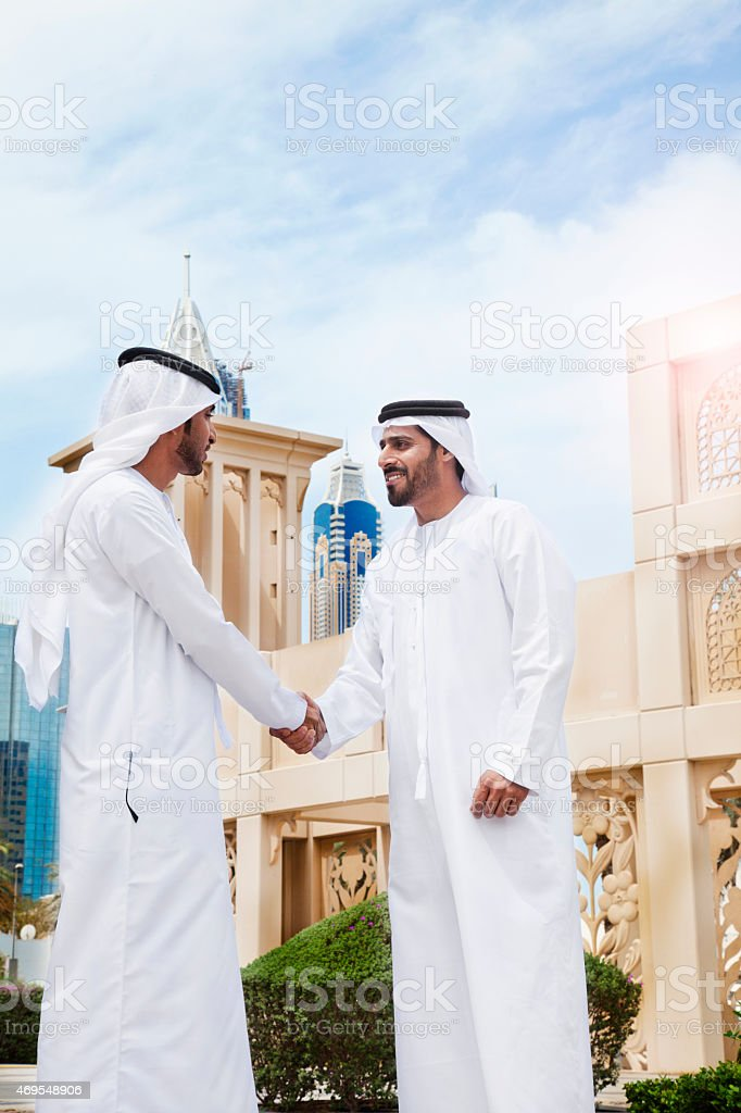 Arab Businessmen In Traditional Clothes In Dubai Stock Photo