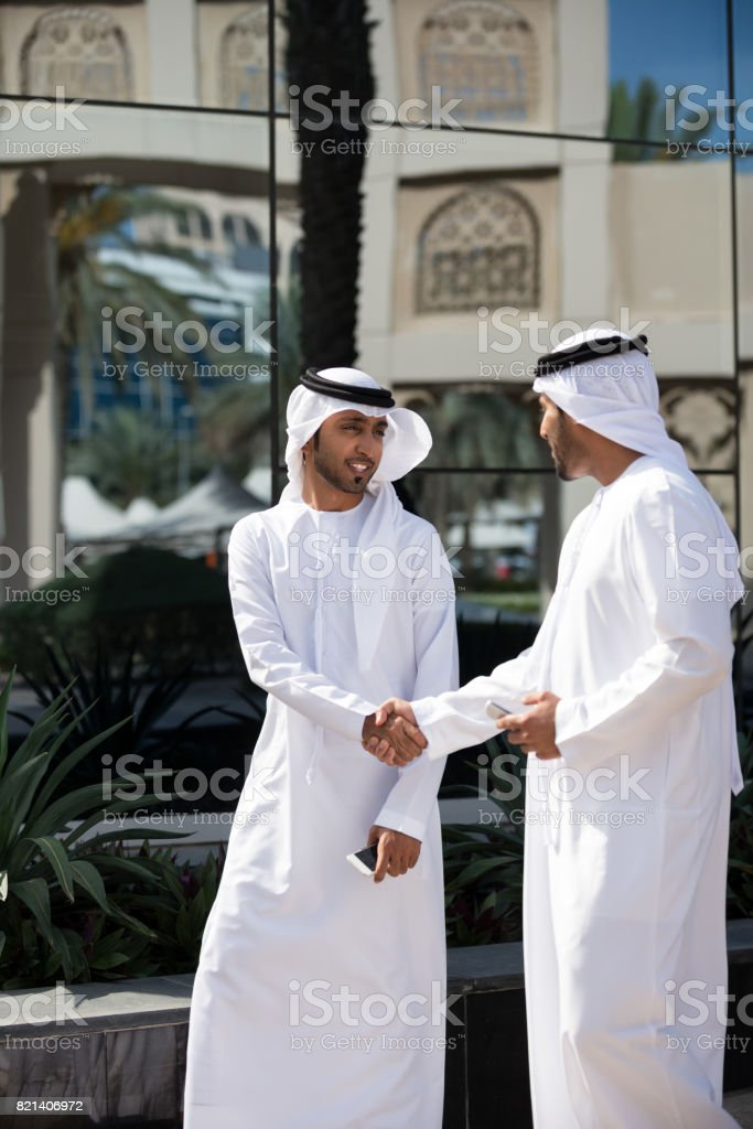 Arab Businessmen with Shaking Hands at Outdoor Business Meeting stock photo