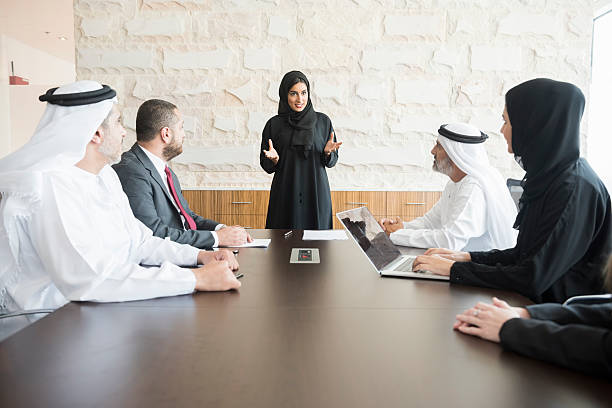 Arab businesswoman giving presentation to colleagues in office stock photo