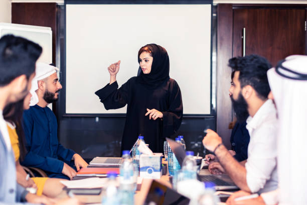 Arab Businesswoman leading a strategy meeting stock photo