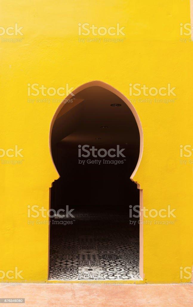 Arab door with yellow walls stock photo