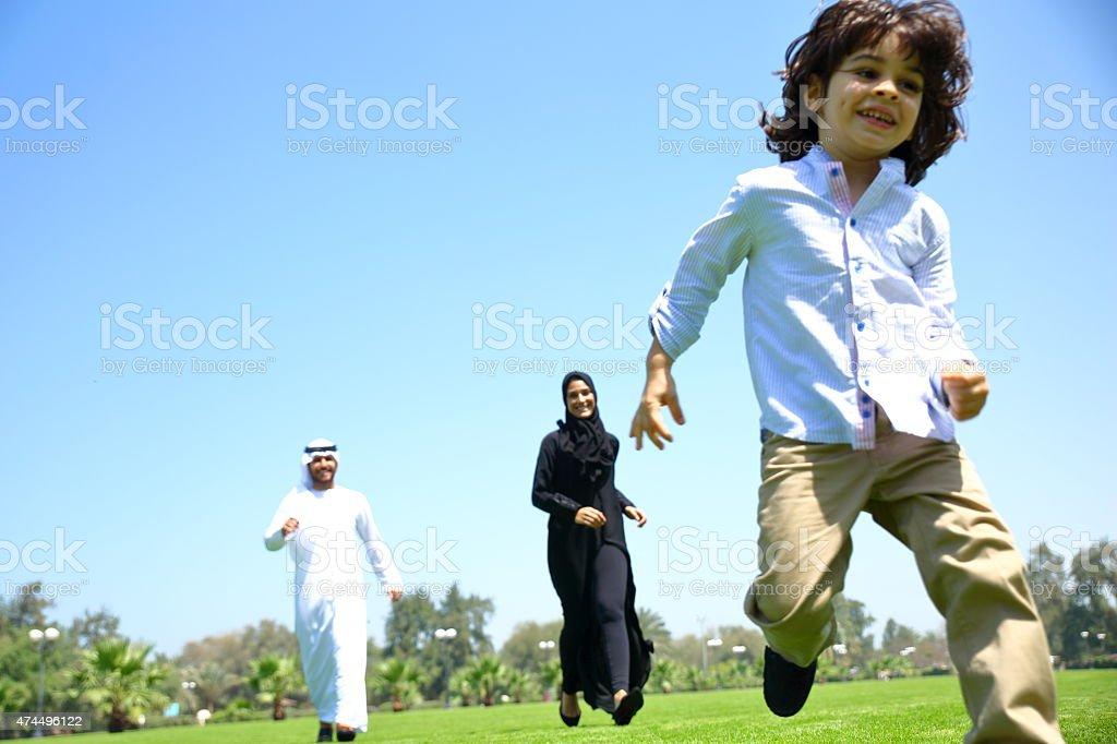 Arab Emirati family outdoors in park stock photo
