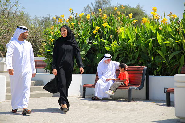 arab emirati family outdoors in park - saudi woman stock photos and pictures