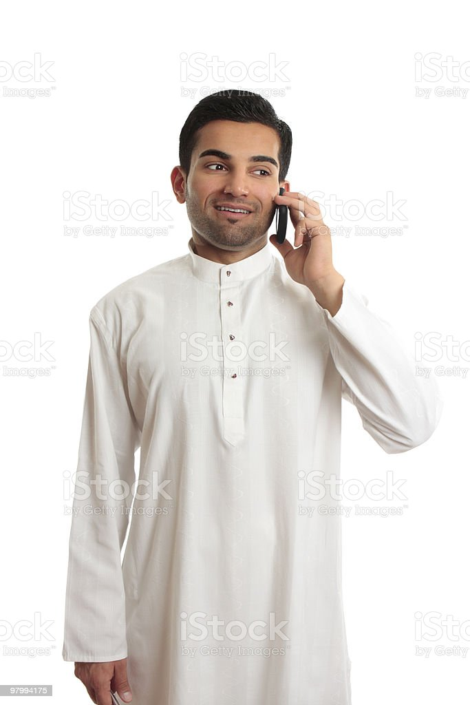 Arab ethnic businessman talking cellphone royalty-free stock photo
