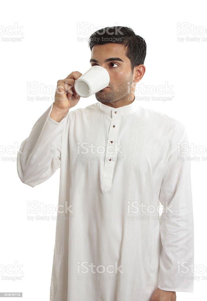 Arab ethnic man drinking coffee royalty-free stock photo