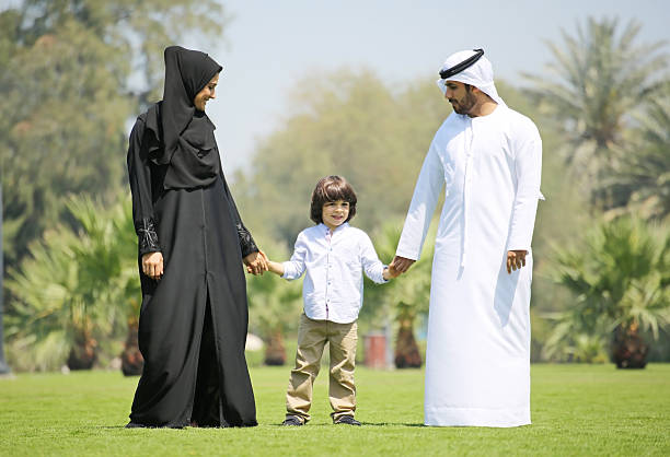 Arab family enjoying their leisure time in park stock photo