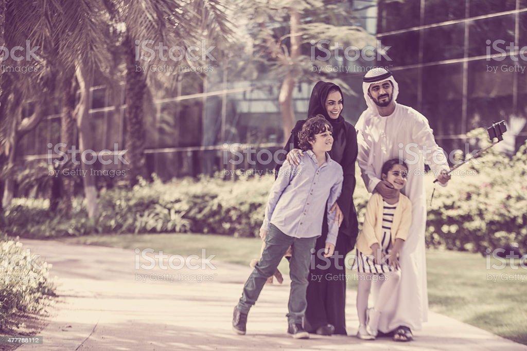 Arab family in park taking selfie stock photo