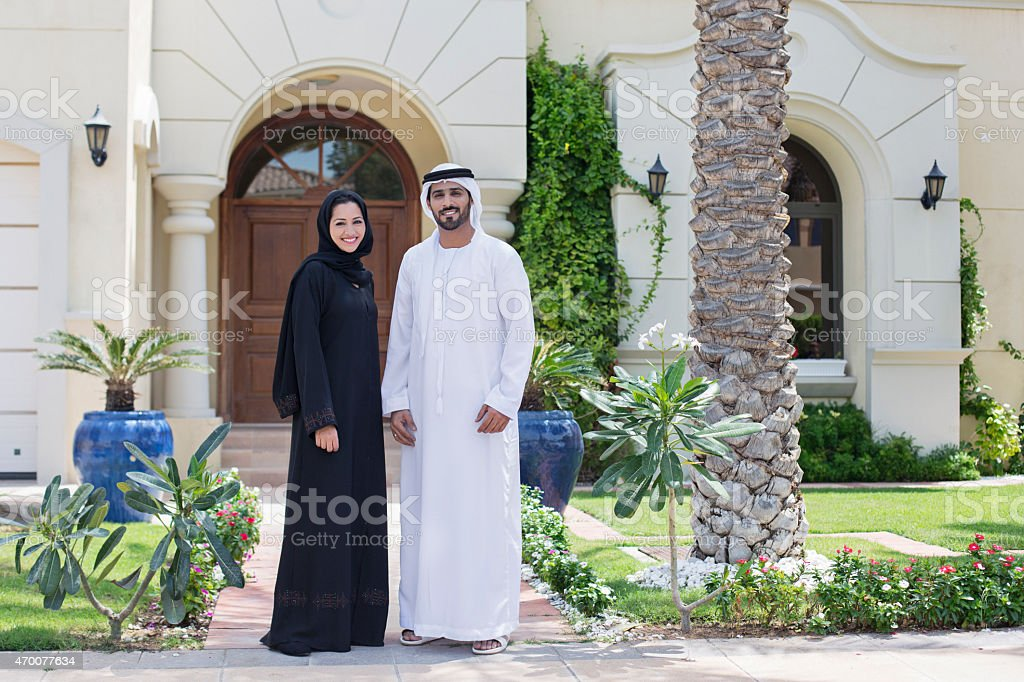 Arab family portrait in front of their house stock photo