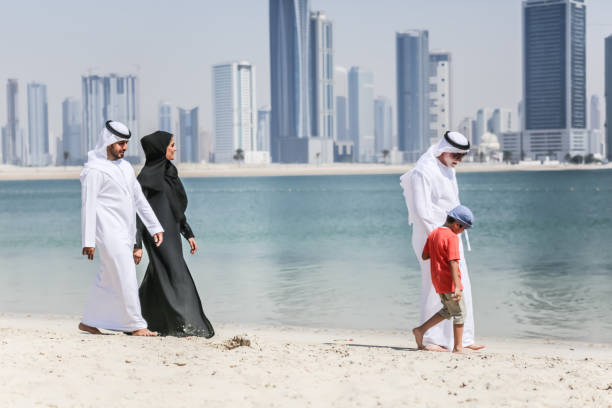 Arab family walking on the autumn beach Arab family walking on the autumn beach saudi arabia stock pictures, royalty-free photos & images