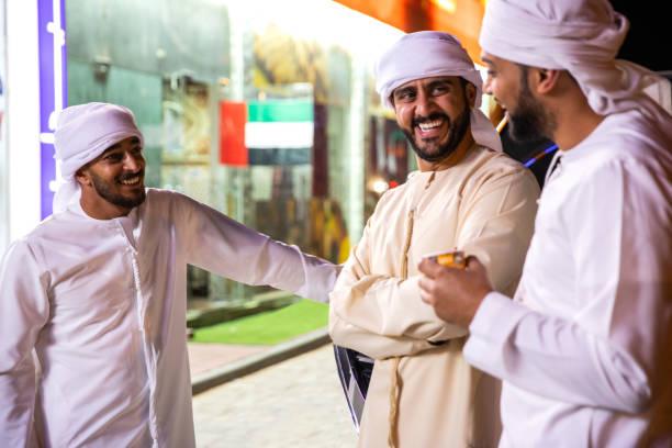 Arab friends enjoy a night spent together in Dubai stock photo