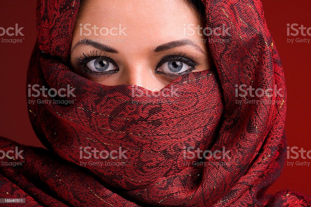 Arab lady in red veil stock photo