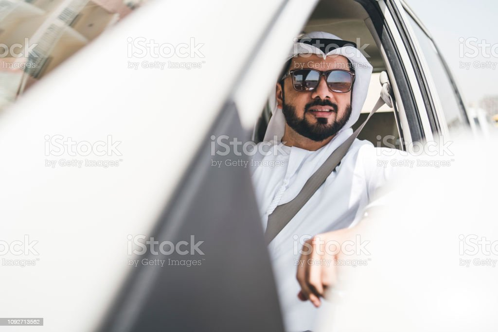Arab man in the car in the city