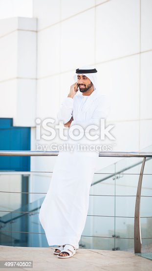 istock Arab Man Managing Business Using Phone During Work Break 499740502