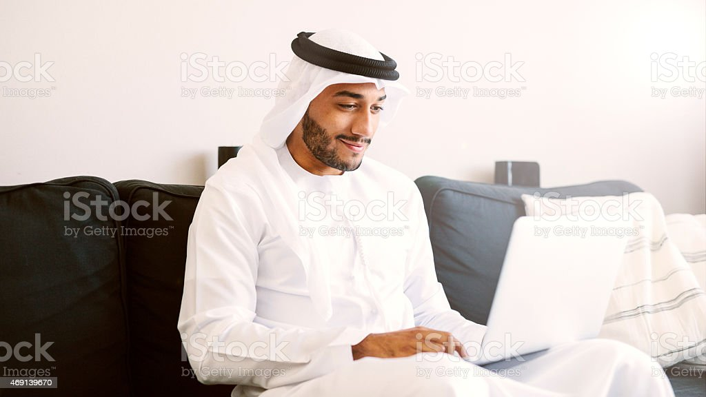 Arab Man Using Laptop stock photo