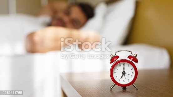 istock Arab man waking up in bed fully rested 1182411766