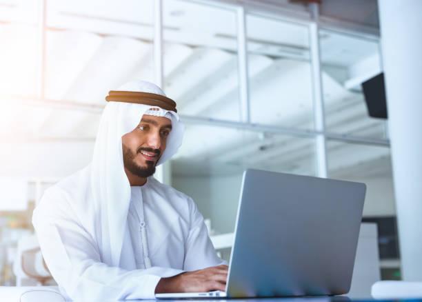 Arab Men Laptop Arab men working on laptop arabia stock pictures, royalty-free photos & images