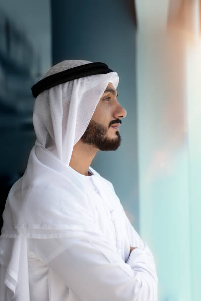Arab men looking Arab men looking outside window arabia stock pictures, royalty-free photos & images