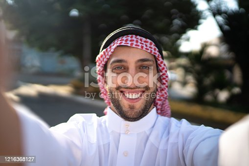 491496340 istock photo Arab Middle East man taking a selfie at street 1216368127