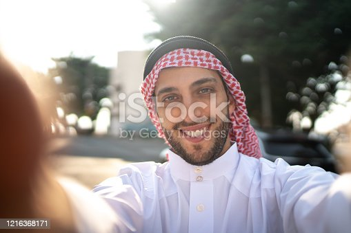 491496340 istock photo Arab Middle East man taking a selfie at street 1216368171