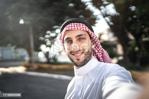 491496340 istock photo Arab Middle East man taking a selfie at street 1219935086
