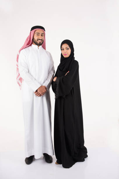 arab muslim couple in traditional dress - saudi woman stock photos and pictures