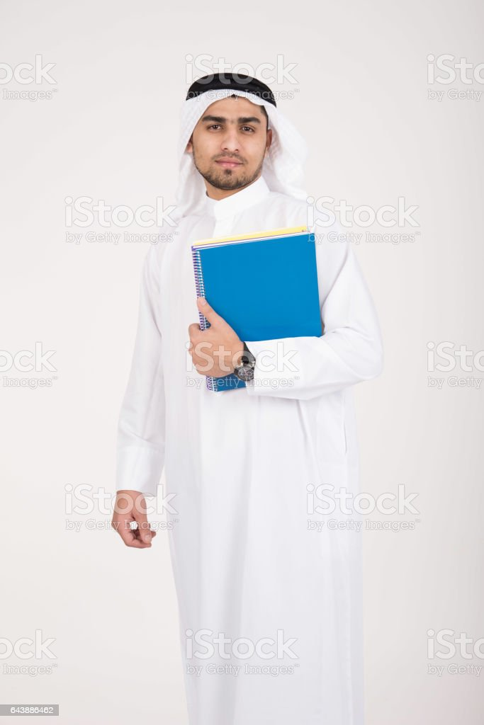 Arab muslim male student in traditional dress stock photo