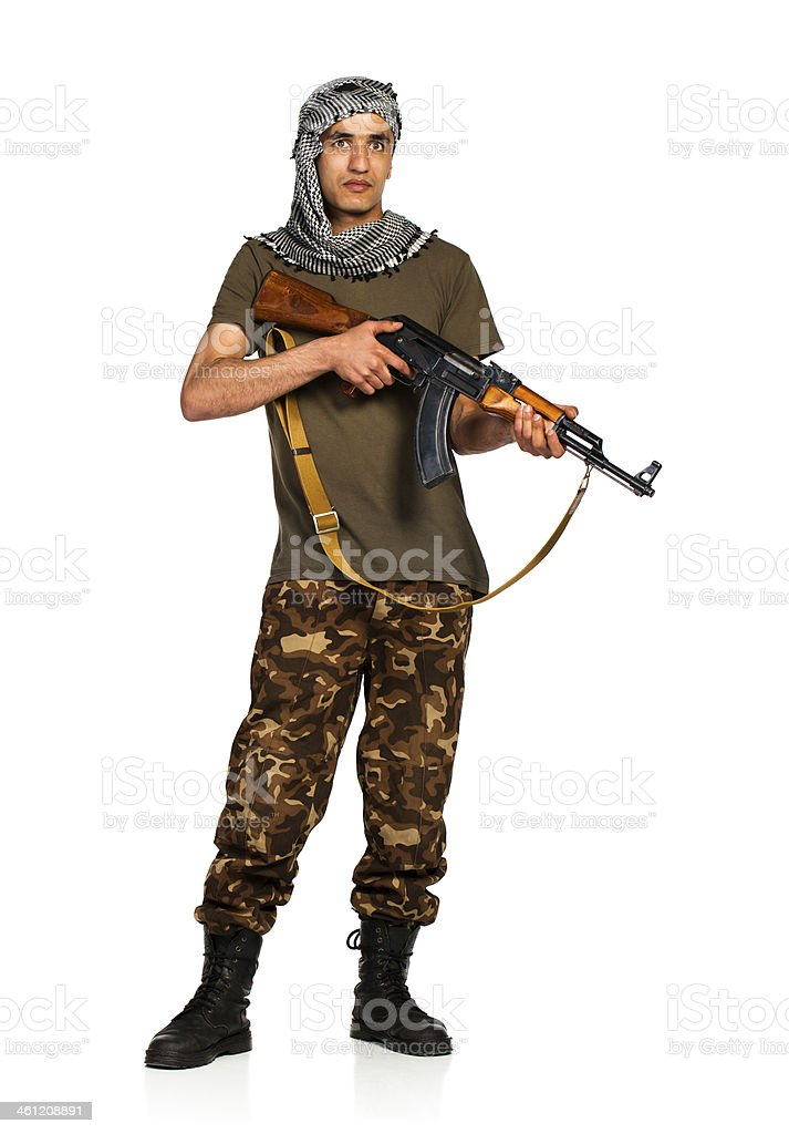 Arab nationality in camouflage suit and keffiyeh with automatic gun stock photo