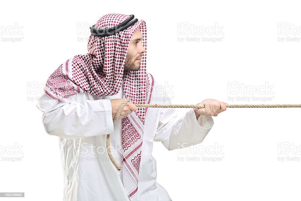 Arab person pulling a rope royalty-free stock photo