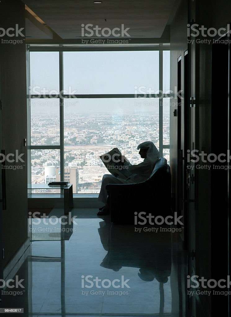 Arab reading newspaper stock photo