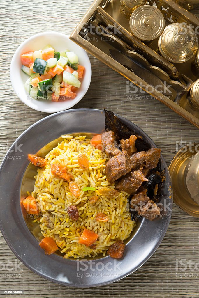 Arab rice, rice with meat and carrot in a bowl. stock photo
