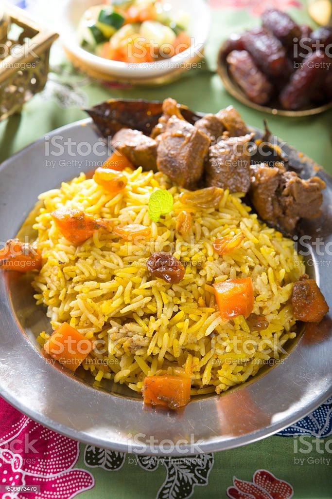 Arab rice, rice with meat and carrot in a bowl stock photo