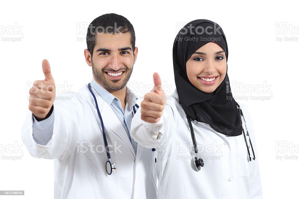 Arab saudi emirates doctors happy with thums up stock photo