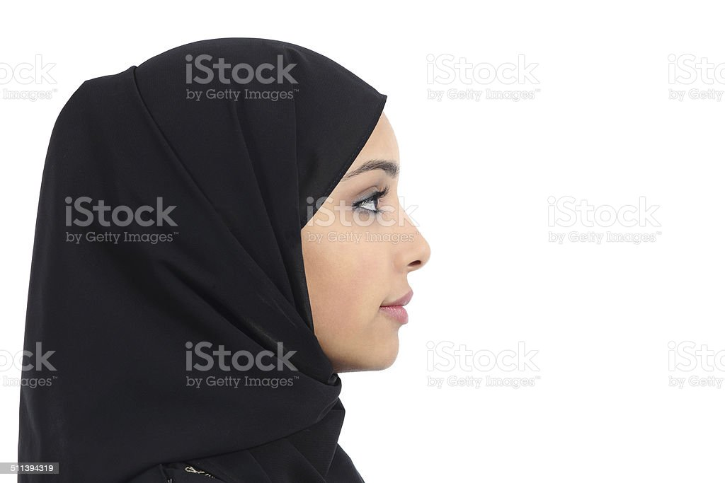 Arab saudi emirates woman covered with black scarf stock photo