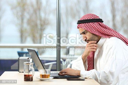 857213750istockphoto Arab saudi man worried with laptop 537107374