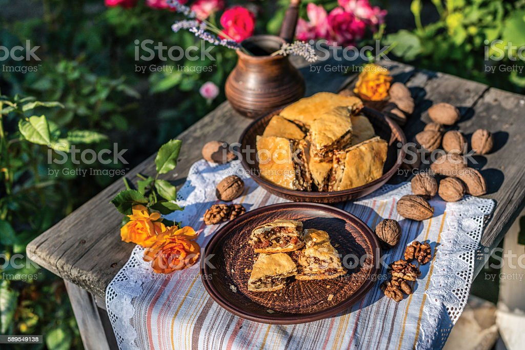 Arab sweets. Pieces of walnut pakhlava is on a clay stok fotoğrafı